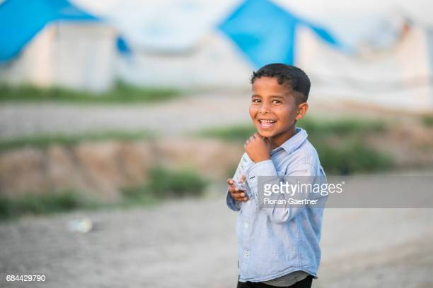 Portrait of a laughing boy in the refugee camp 'Hasansham U3' near Hasansham on April 20 2017 in Hasansham Iraq