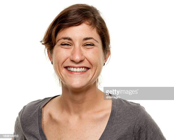 Portrait of a laughing young woman over white background