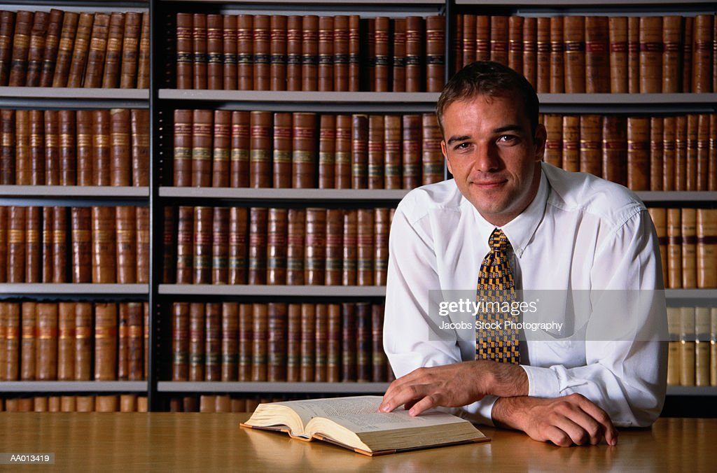 Portrait of a Lawyer in a Library : Stock Photo