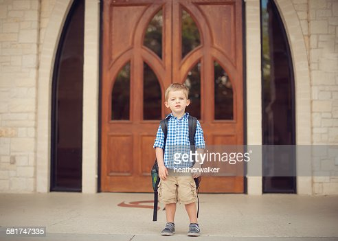 Portrait of a little boy on his first day of school