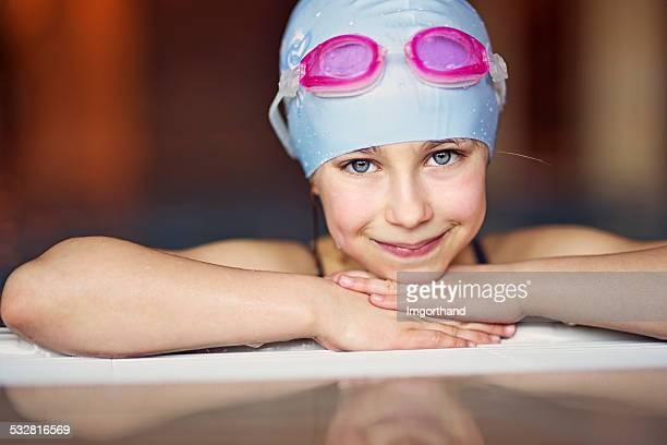 Portrait of a little girl in swimming pool
