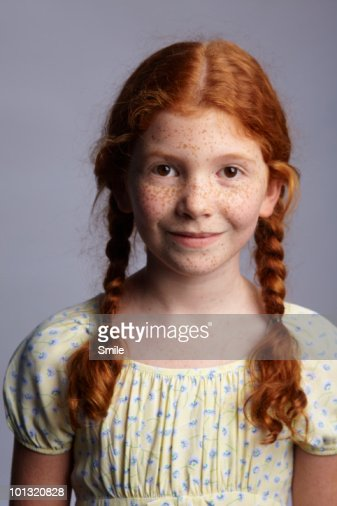 Portrait of a little redhead girl