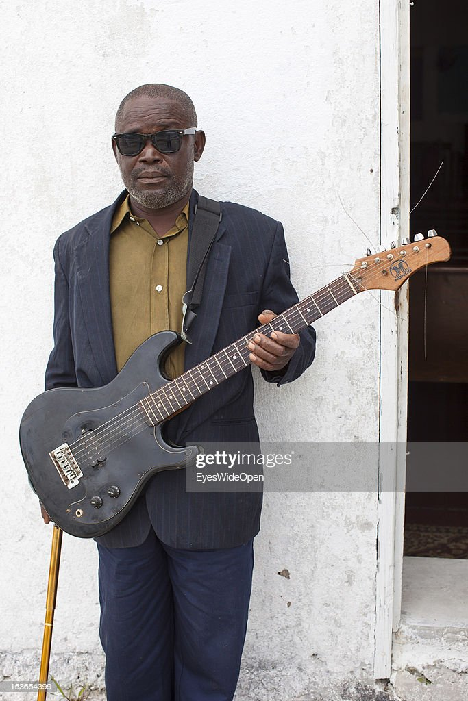 Portrait of a local bahamian old and blind man, a guitar player who performs at the sunday service in the Zion Baptist Church in Old Bight on June 15, 2012 in Cat Island, The Bahamas.