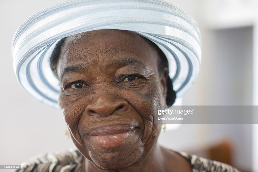 Portrait of a local bahamian old woman, the lady is wearing a hat while attending the sunday service in the Zion Baptist Church in Old Bight on June 15, 2012 in Cat Island, The Bahamas.