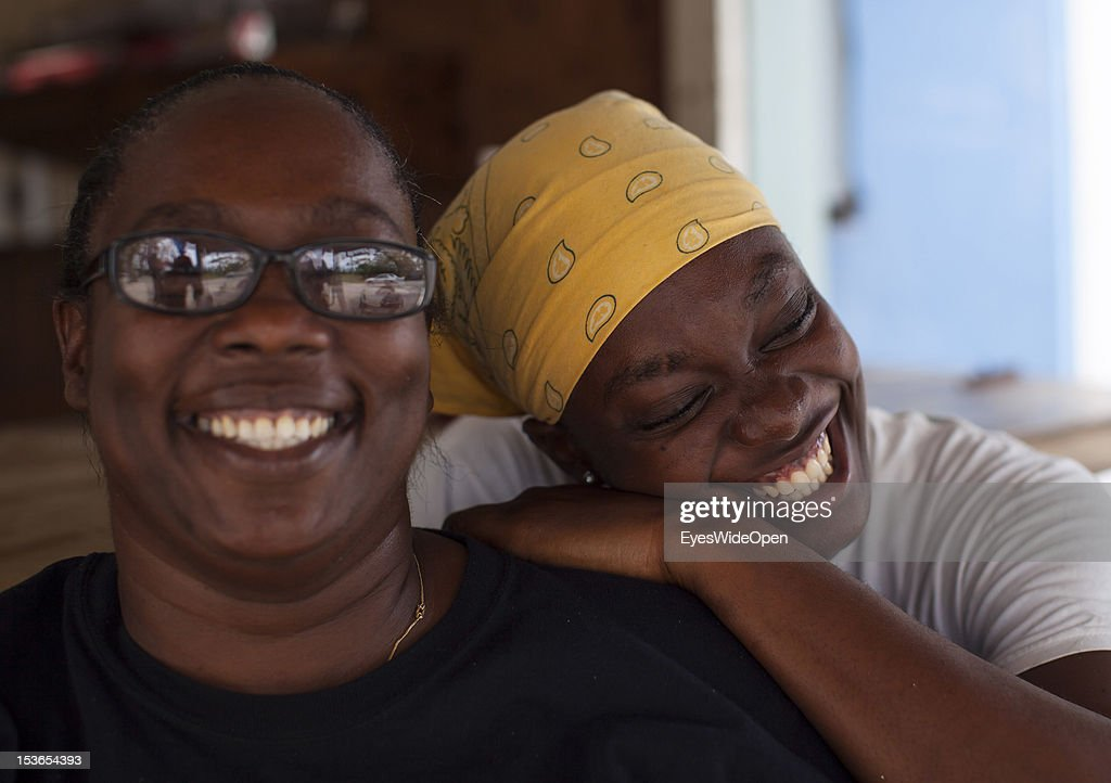 Portrait of a local bahamian woman and mother with her daughter at their foodstall at New Bight Beach on June 15, 2012 in Cat Island, The Bahamas.