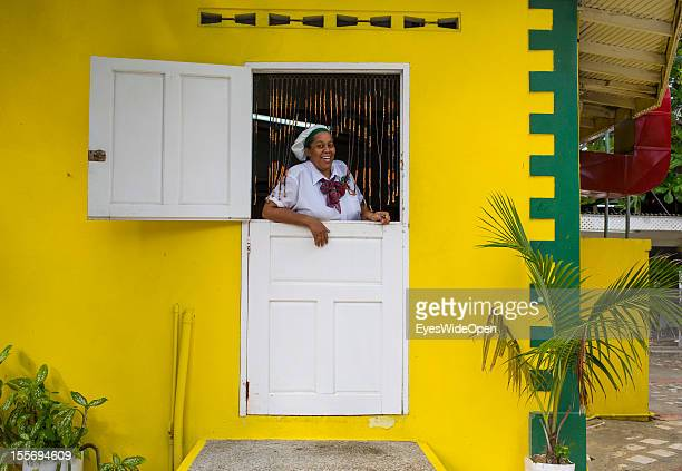 Portrait of a local woman working as a cook in a restaurant on October 21 2012 in Scarborough Trinidad And Tobago