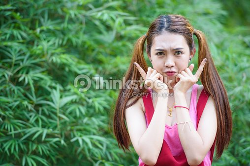 Portrait Of A Lovely Girl With 2 Pony Tails Hairstyle Stock Photo