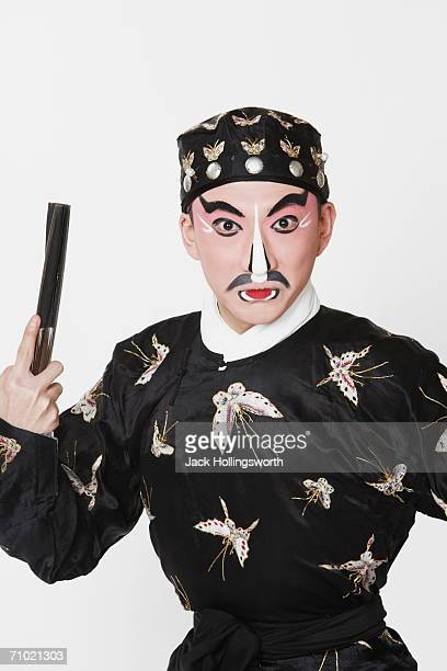 Portrait of a male Chinese opera performer holding a fan