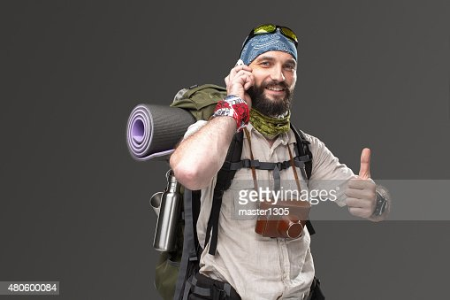 Portrait of a male fully equipped tourist : Stock Photo