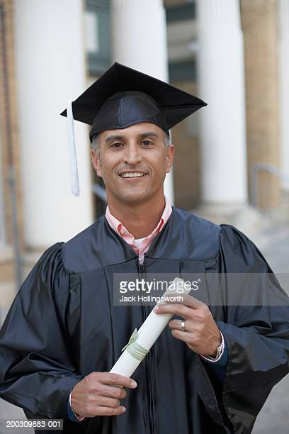 Portrait of a male graduate holding a diploma