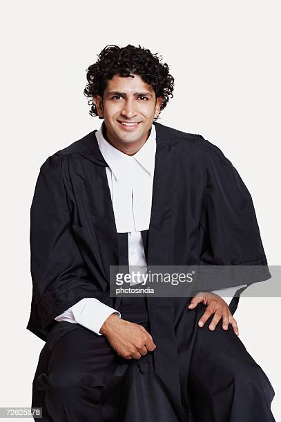 Portrait of a male lawyer sitting and smiling