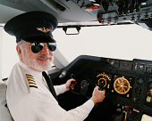 Portrait of a Male Pilot Sitting in the Cockpit
