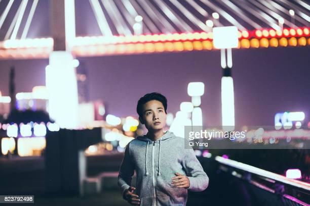 Portrait of a male urban runner at night