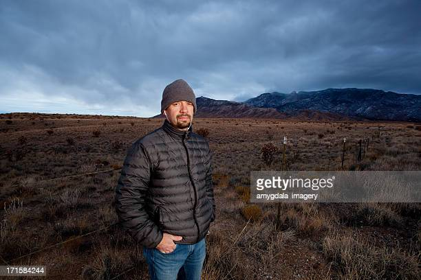 portrait of a man and desert mountain landscape