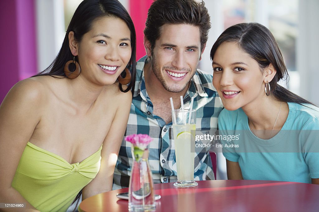 Portrait of a man and women with lime juice on table in a restaurant : Stock Photo
