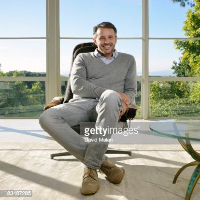 Portrait of a man at home in a lounge chair