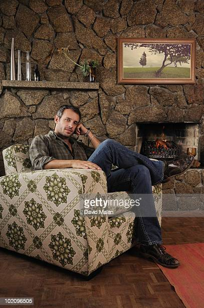 Portrait of a man at home (sitting in armchair)