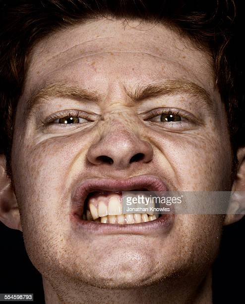 Portrait of a man clenching teeth