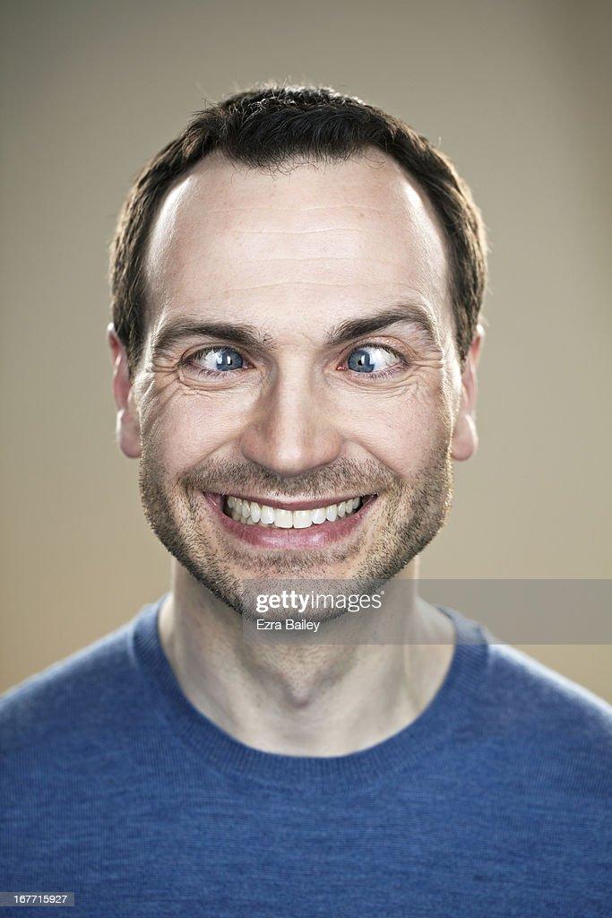 Portrait of a man cross eyed.