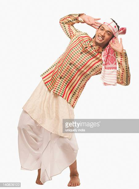 Portrait of a man dancing on Bihu festival