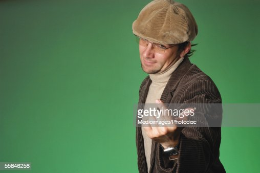 Portrait of a man gesturing with his hand : Stock Photo