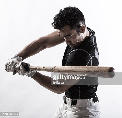 Portrait of a man holding a baseball bat : Stock Photo