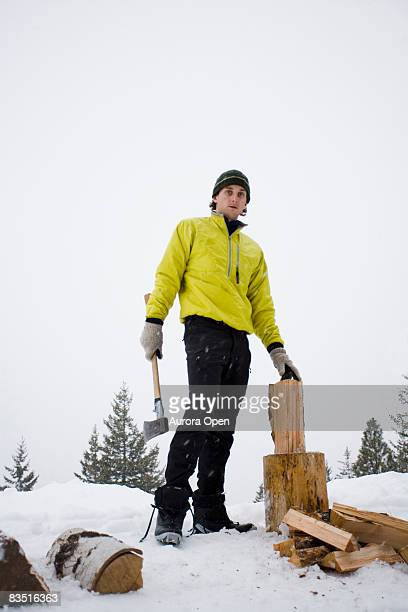 A portrait of a man holding an ax in a winter storm, Winthrop, Washington.