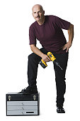 Portrait of a man holding an electric drill