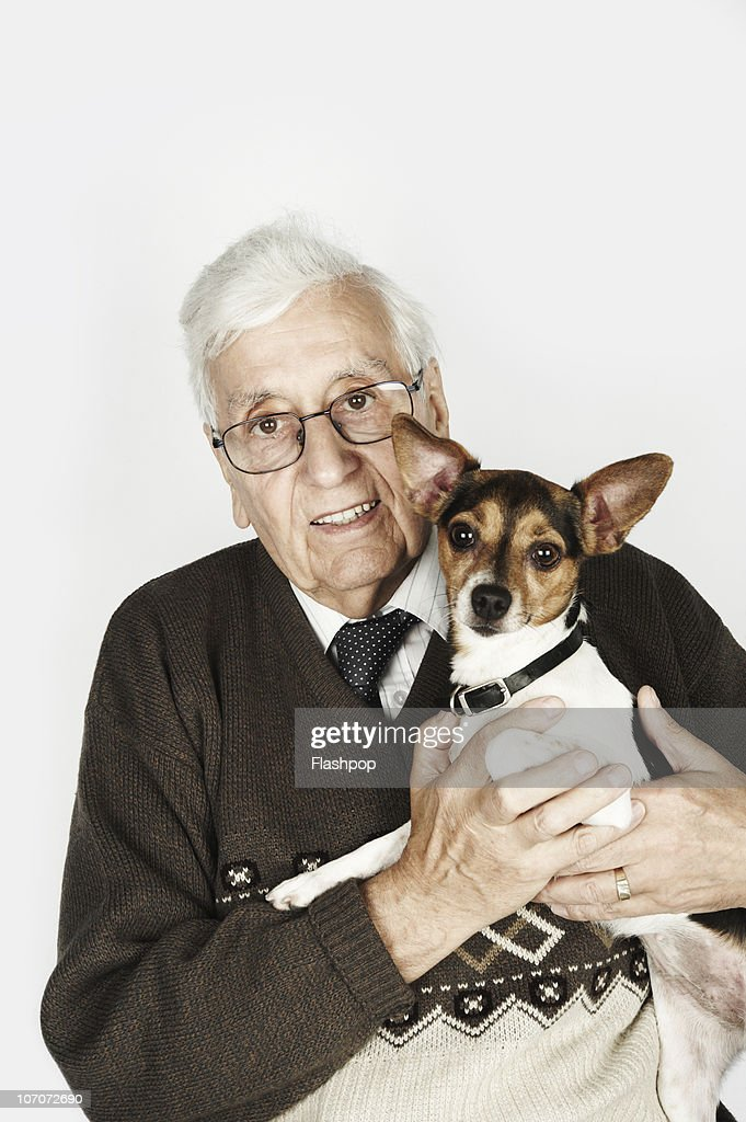 Portrait of a man holding his pet dog : Stock Photo