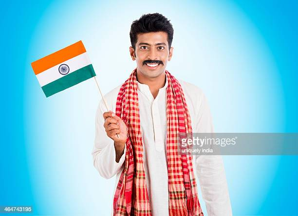 Portrait of a man holding Indian flag and smiling