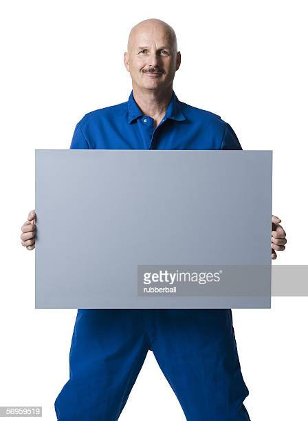Portrait of a man holding up a blank sign