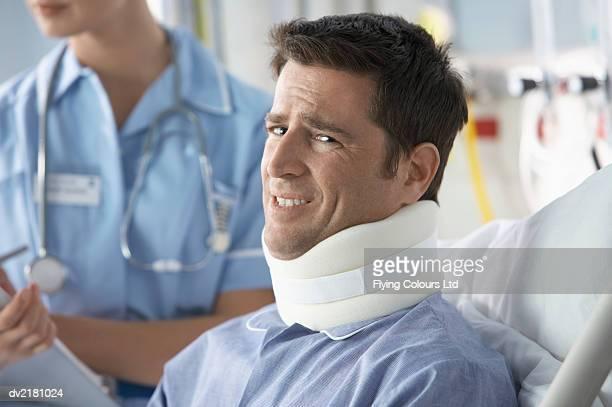 Portrait of a Man in a Hospital Bed Wearing a Neck Brace