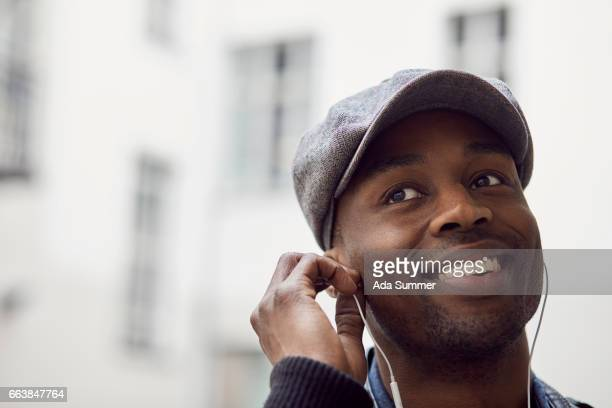 portrait of a man listening to a audio guide