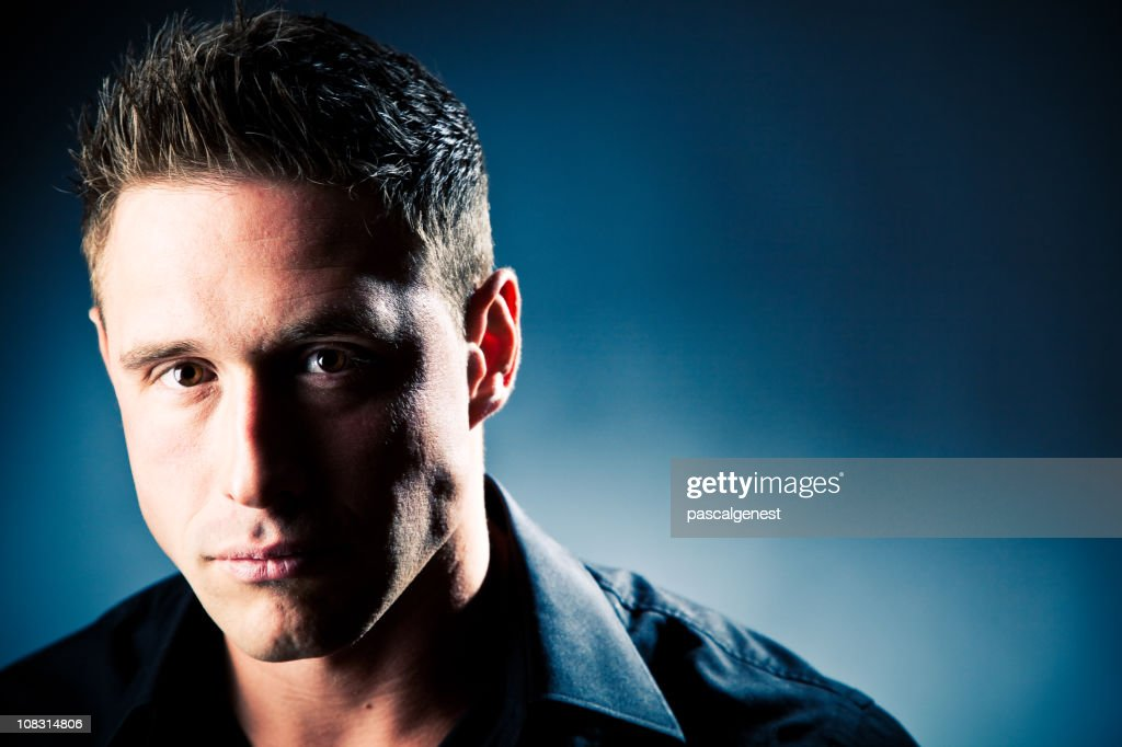 Portrait of a man looking at the camera : Stock Photo