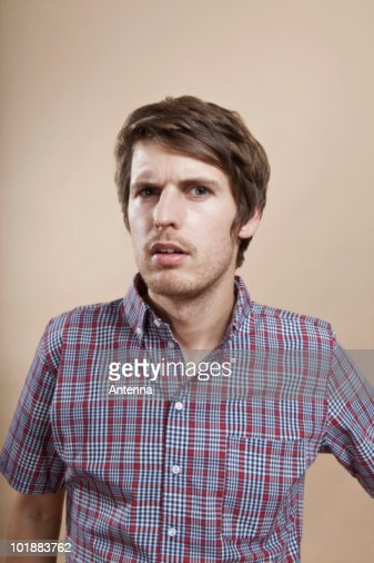 Portrait of a man looking confused, studio shot