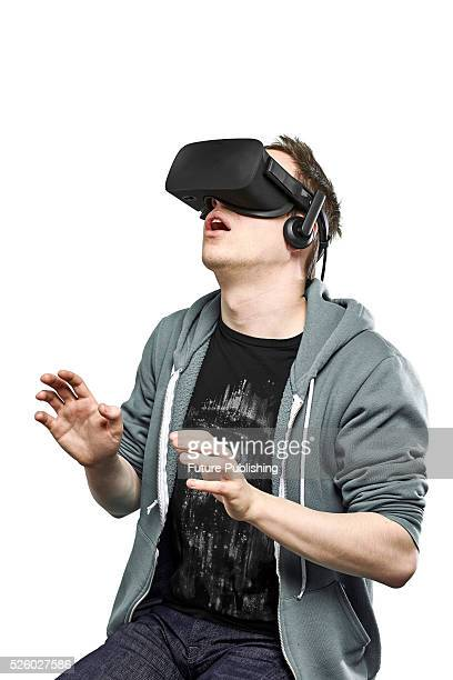 Portrait of a man looking shocked while wearing an Oculus Rift virtual reality headset taken on April 13 2016