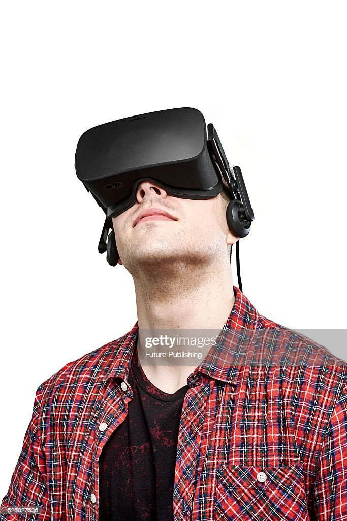 Portrait of a man looking up while wearing an Oculus Rift virtual reality headset, taken on April 13, 2016.