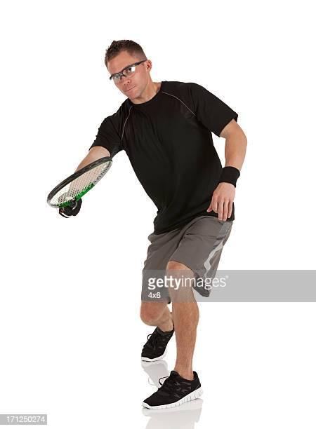 Retrato de um homem Jogando racquetball