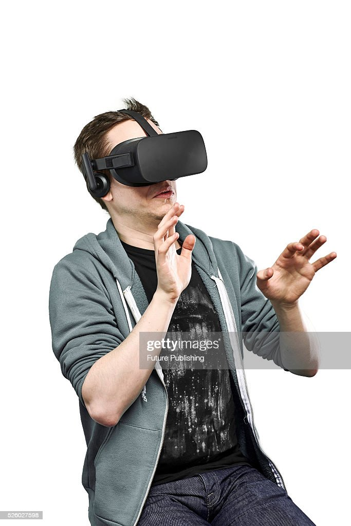 Portrait of a man recoiling while wearing an Oculus Rift virtual reality headset, taken on April 13, 2016.