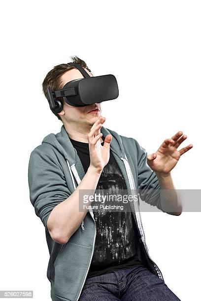 Portrait of a man recoiling while wearing an Oculus Rift virtual reality headset taken on April 13 2016