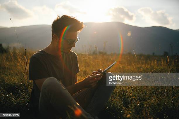 Portrait of a man relaxing in the outdoors, reading