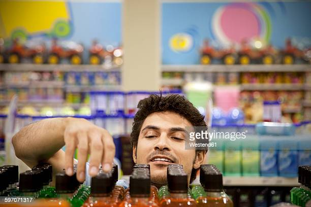 Portrait of a man searching product in a supermarket