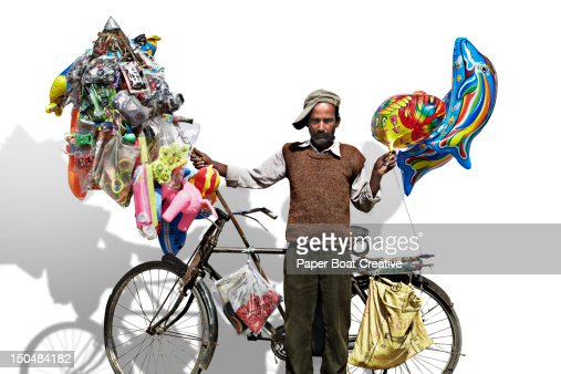 portrait of a man selling toys and balloons