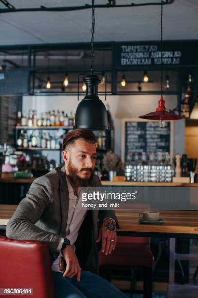 Portrait of a man sitting in a bar