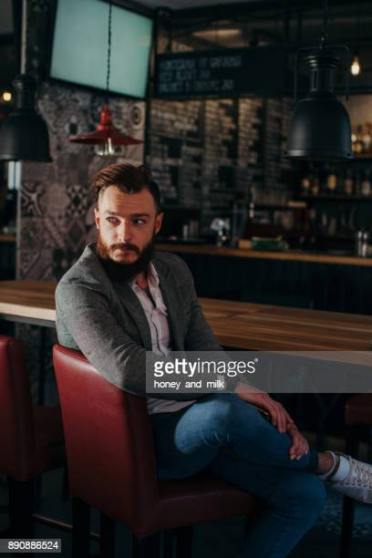 Portrait of a man sitting in a cafe