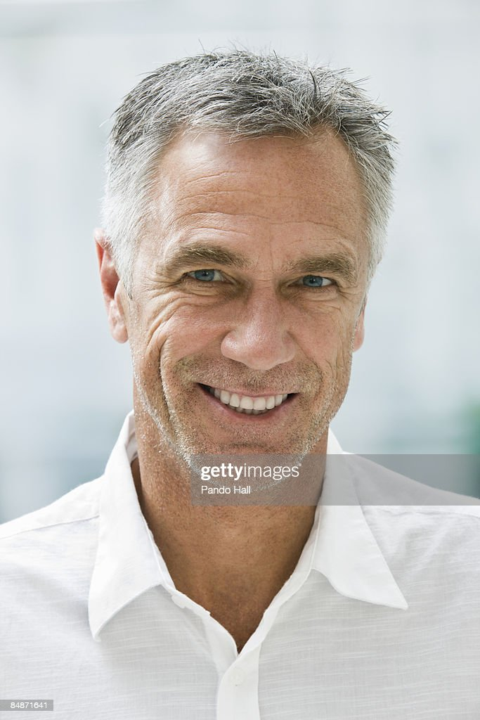 Portrait of a man smiling, close-up : Stock Photo