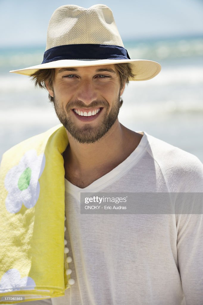 Portrait of a man smiling on the beach