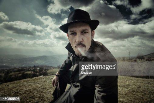 Portrait of a man smoking a cigarette : Stock Photo