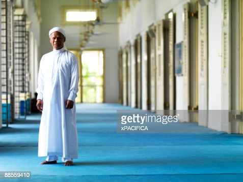 A portrait of a man standing in a Mosque. : Stock Photo
