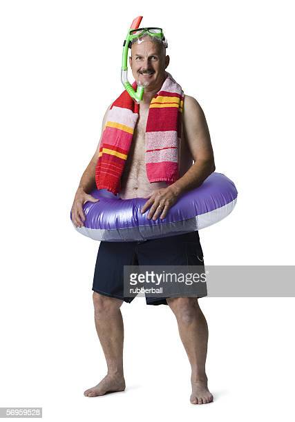 Portrait of a man standing with an inflatable ring around his waist